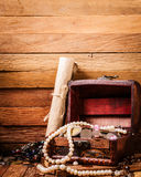 Open wooden treasure chest with valuables Stock Photography