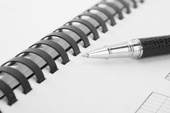 Open writing book and black pen Stock Photography