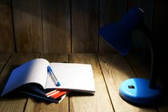 Open writing-book and the fixture. Stock Image