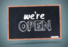 We are open written on chalkboard Royalty Free Stock Photo