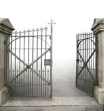 Open wrought-iron gate. Entrance of a graveyard with a open wrought-iron gate in gradient back and clipping path stock photography