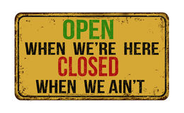 Open when we're here closed when we ain't vintage  metal sign Stock Photo