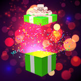 Open Xmas box with confetti on bokeh background. Vector Royalty Free Stock Image