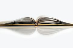 Open yellow book on white backgroud Royalty Free Stock Photo