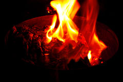 Open yellow flames and burning embers Stock Image