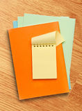 Open yellow notepad on colored paper Royalty Free Stock Photo