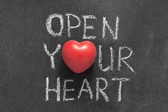 Open your heart. Phrase handwritten on chalkboard with heart symbol instead of O Royalty Free Stock Photo