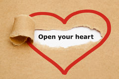 Open Your Heart Torn Paper. Open your heart, appearing behind torn brown paper royalty free stock photo