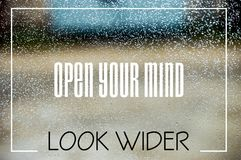 Open your mind and look wider. Great quality work. On this picture you can see business and social concept motivational quotes on blurred background stock photo
