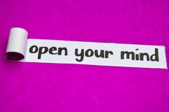 Open Your Mind text, Inspiration, Motivation and business concept on purple torn paper stock photos