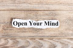OPEN YOUR MIND text on paper. Word OPEN YOUR MIND on torn paper. Concept Image Stock Photography