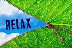 Relax word under zipper leaf. Open zipper leaf and showing sky with relax word stock photos