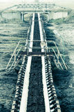 Opencast brown coal mine. Belt conveyor. Royalty Free Stock Images