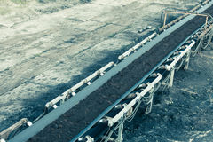 Opencast brown coal mine. Belt conveyor. Royalty Free Stock Photography