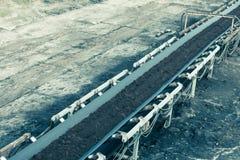 Opencast brown coal mine. Belt conveyor. Royalty Free Stock Photography