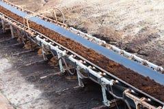 Opencast brown coal mine. Belt conveyor. Stock Photos