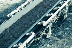 Opencast brown coal mine. Belt conveyor. Stock Photography