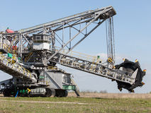 Opencast brown coal mine. Bucket wheel excavator. Stock Photography