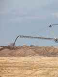 Opencast brown coal mine. Giant excavator. Royalty Free Stock Images