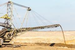 Opencast brown coal mine. Giant excavator. Royalty Free Stock Image