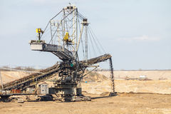 Opencast brown coal mine. Giant excavator. Royalty Free Stock Photo