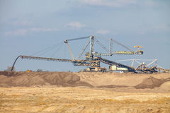 Opencast brown coal mine. Giant excavator. Royalty Free Stock Photos