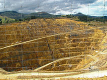 Opencast gold mine New Zealand seen behind wire fence. Stock Images