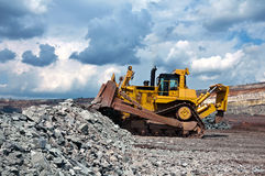Opencast mine. A picture of a big yellow bulldozer at worksite Stock Image