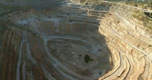 Opencast mining quarry with lots omachinery at work. stock video