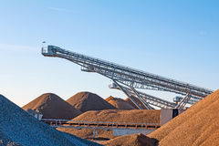 Opencast pit. Conveyor nelts and gravel heaps at an industrial Plant for mining of basic materials Royalty Free Stock Images