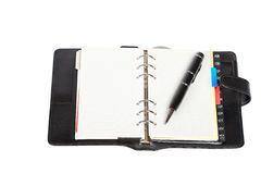 Opened agenda with pen Royalty Free Stock Photos