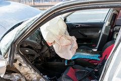 Opened airbag on Volkswagen Golf after side collision. royalty free stock photo