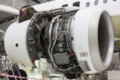 Opened aircraft engine in the hangar. Opened aircraft engine repair in the hangar Royalty Free Stock Images