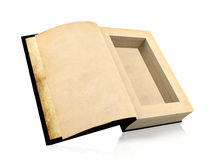 Opened ancient paper book with a hole in a middle for hiding something inside Stock Image