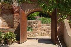 An opened ancient wood gate in Alhambra, Granada, Spain Royalty Free Stock Photos