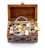 Opened ash wood carved casket handmade with jewelry isolated Stock Photo