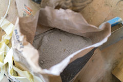 Opened bag of dry cement Royalty Free Stock Photos