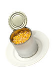 Opened bank of canned corn on a white plate Royalty Free Stock Images