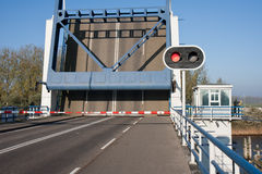 Opened bascule bridge in the Netherlands. With red stop sign Stock Photos