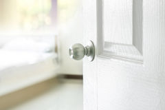 Opened bedroom door. Opened the white bedroom door royalty free stock photos