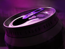 Opened beer (coke) can. Close up. Opened beer (coke) can. Close up, dark, purple illuminated royalty free stock photography