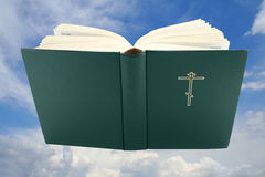 Opened bible book over sky with clipping path Stock Photos