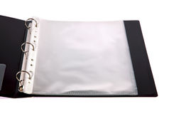 Opened binder with plastic pockets. Opened Three-rings binder with plastic pockets Stock Images