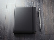 Opened black copybook with silver pen. 3d rendering stock illustration