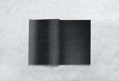 Opened blank magazine black pages mockup Stock Image