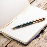 Opened blank notebook with elegant fountain pen Royalty Free Stock Photography