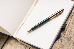 Opened blank notebook with elegant fountain pen Royalty Free Stock Images