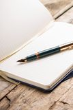 Opened blank notebook with elegant fountain pen Stock Photography