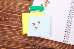 Opened blank notebook, frame of school supplies over a  retro wo Royalty Free Stock Photos