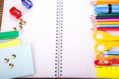 Opened blank notebook, frame of school supplies over a  retro wo Stock Images